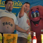 Hot Dog Eating Contest competitors get psyched before the contest begins.