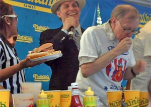The Nathan's host urges on Richard LeFevre of Henderson, NV.