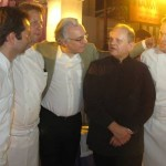 Chefs Alain Ducasse, Joël Robuchon and brigade in front of the Joël Robuchon food station on Friday night