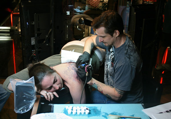 Tiziana had no idea she would end up getting a tattoo when she traveled to Las Vegas from London. Above, she spends National Tattoo Day getting inked with a koi fish by tattoo artist Joey Hamilton at Club Tattoo in the Miracle Mile Shops. Photo by Howard Freeman