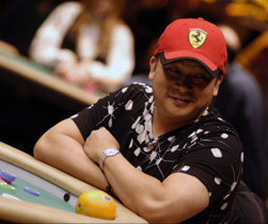 Johnny Chan with his lucky orange