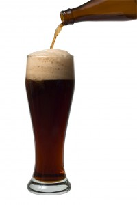 A beer pouring into a glass