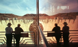 Tourists are reflected in a window at the visitor's center while they take in the view of the Hoover Dam. Photo Courtesy of Las Vegas Sun/Sam Morris