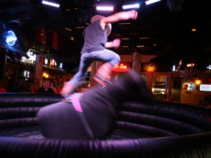 The bull operator at Gilley's Saloon and Dance Hall surfs the mechanical bull.