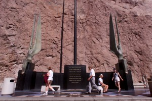 "Tourists walk past the outdoor sculpture titled ""Winged Figures of the Republic"" at the Hoover Dam. Photo courtesy of Las Vegas Sun/Sam Morris"