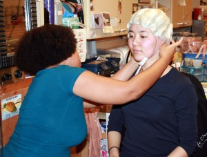 """New cast member Yukako Kobayashi is fitted for a wig by Shenelle King, a headpiece technician in """"Le Rêve"""" at Wynn Las Vegas."""