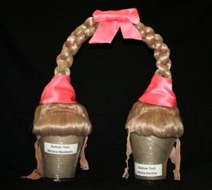 "Two acrobats' heads go into this Siamese twin wig created for ""LOVE"" at The Mirage."