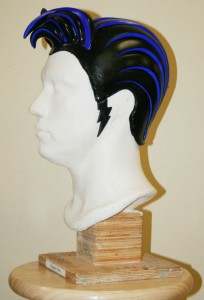 "A urethane foam wig re-creates the King's famed hairstyle in ""Viva ELVIS"" at Aria."