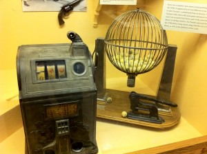 An early slot machine and bingo cage.