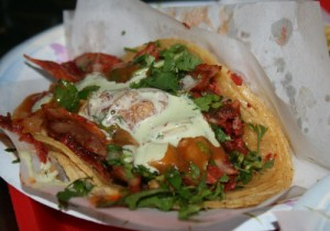At just $2 each, tacos like this spicy pork with pineapple at Tacos El Gordo are a great deal.