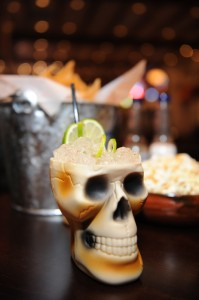 You can celebrate Dia de los Muertos in style with this mug at Hussong's. Photo by Denise Truscello.