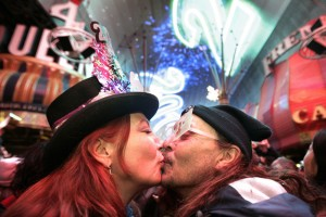 June Day and her boyfriend Joe Hansen, both of Las Vegas, kiss at the stroke of midnight during New Year's TributePalooza on Jan. 1, 2011. Photo: Leila Navidi, Las Vegas Sun.