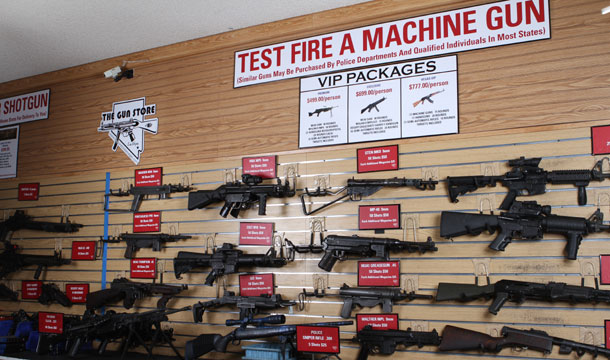 A wall at The Gun Store displays the assortment of guns visitors can test fire on the range.
