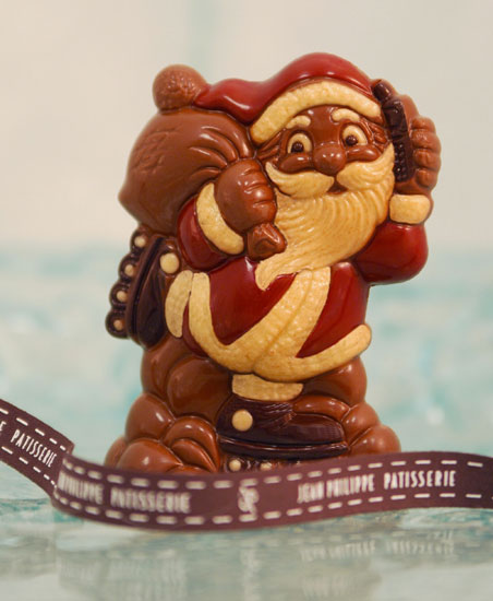 At Jean Philippe Pâtisserie, this hand-decorated rollerblading Santa is made from the finest European chocolate.