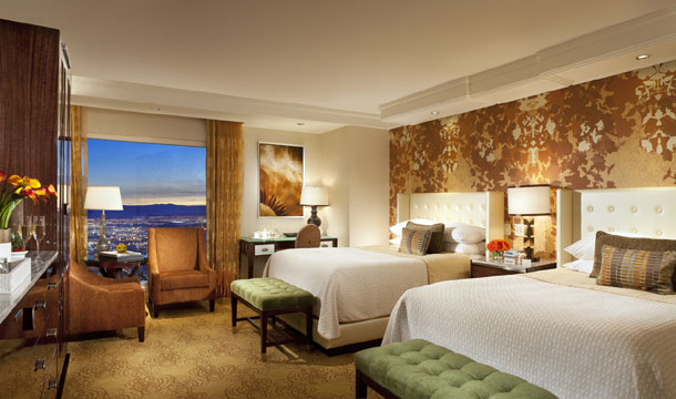 This remodeled double queen room features the amber and butterscotch color palette.