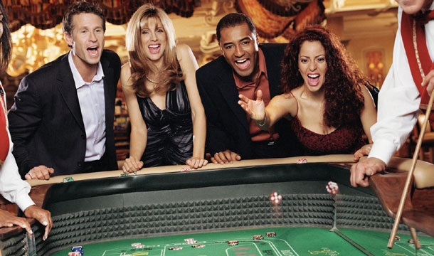 Visitors playing craps at Bellagio (Photo courtesy of MGM Resorts International)