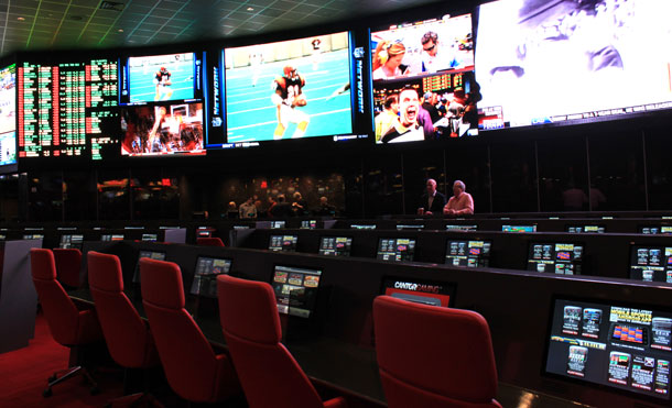 The carrels and video screen at Cantor Race and Sports Book inside the Palms