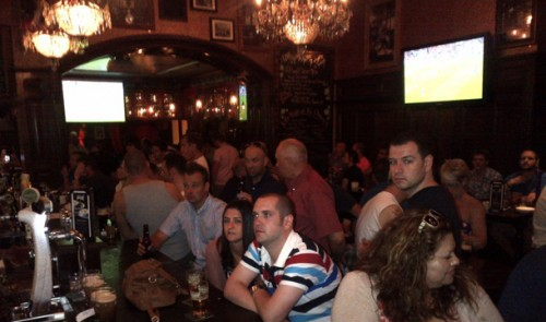 Patrons watching a sporting event at Rí Rá