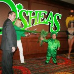 "Eileen Moore, regional president and general manager of The Quad, and Mr. Lucky the Leprechaun (aka Brian Thomas) officially opened O'Sheas Casino at the end of 2013 along with ""Jubilee!"" showgirls and other dignitaries (photo by Jennifer Whitehair)"