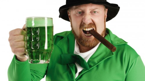 Green beer drinking leprechaun from Photos.com