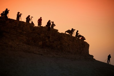 Photographers at sunrise by littleny / Getty Images.