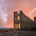 Rhyolite Ruins and sunset by Paul Lemke / Getty Images.