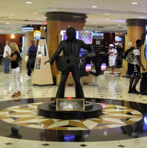 The famous life-size bronze statue of Elvis Presley is now in the house