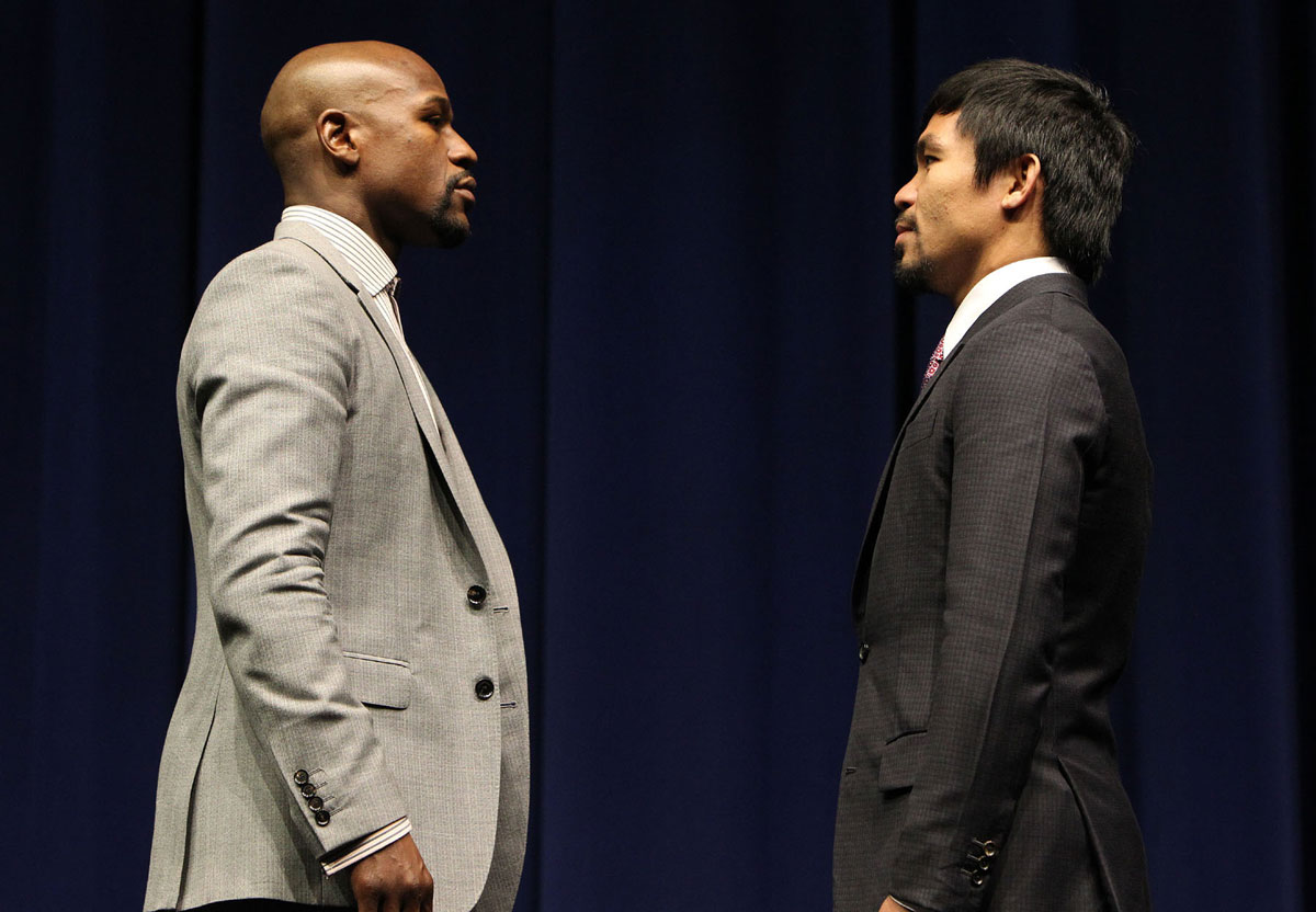 Floyd Mayweather Jr. and Manny Pacquiao face off during the March press conference announcing their fight (photo by Chris Farina/Top Rank)