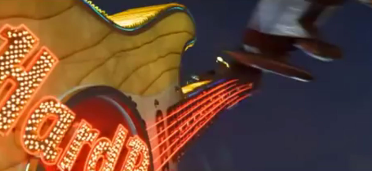 "Screenshot of a plane slicing off the neck of the giant neon guitar in front of the Hard Rock Hotel & Casino from the ""Con Air"" film, courtesy of Touchstone Pictures and Jerry Bruckheimer Films."