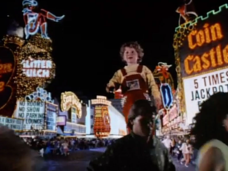 "Screenshot of a giant boy running wild and causing mayhem on Fremont Street from the ""Honey, I Blew Up the Kid"" film, courtesy of Walt Disney Pictures."