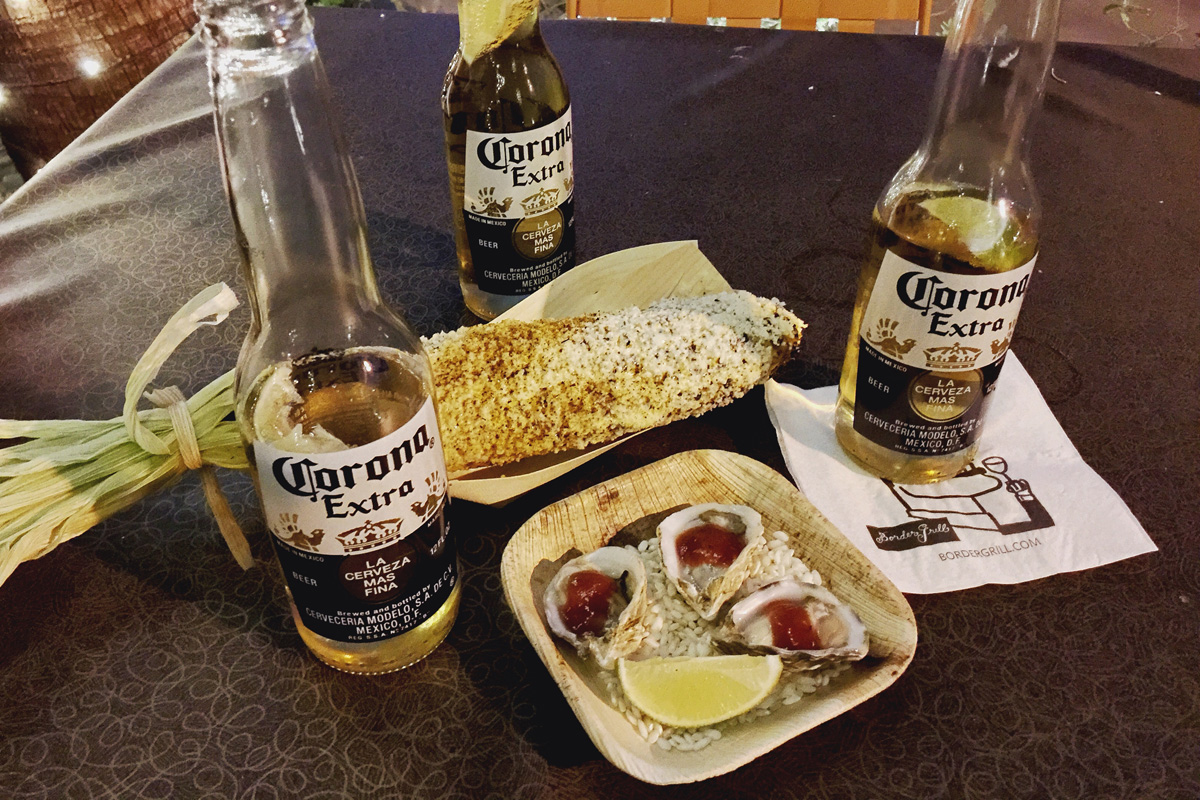Border Grill's grilled Mexican corn, oysters and beer at the pre-concert party Backyard Barbeque, photo courtesy of: Alonzo Wright