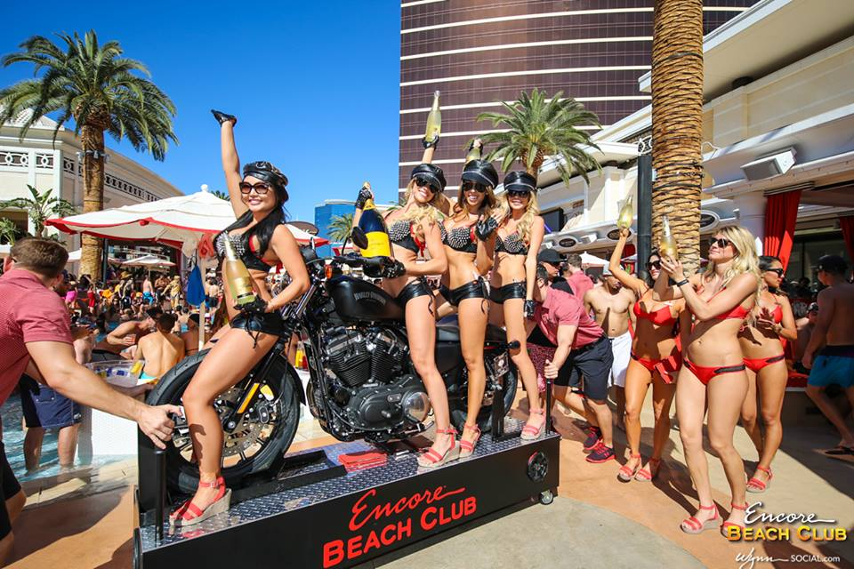 No, you can't drive the motorcycle around the pool. But if you drink enough you might feel like you have. Photo courtesy of Encore Beach Club.