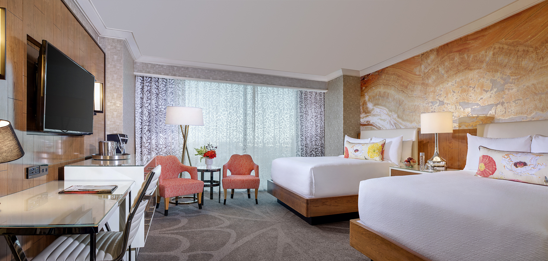 mandalay bay s remodeled hotel rooms give a beach vibe year round mandalay bay resort queen gold bed