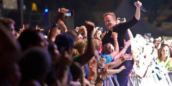 Dan Reynolds of Imagine Dragons with fans at Life is Beautiful 2013, photo courtesy of Las Vegas Sun
