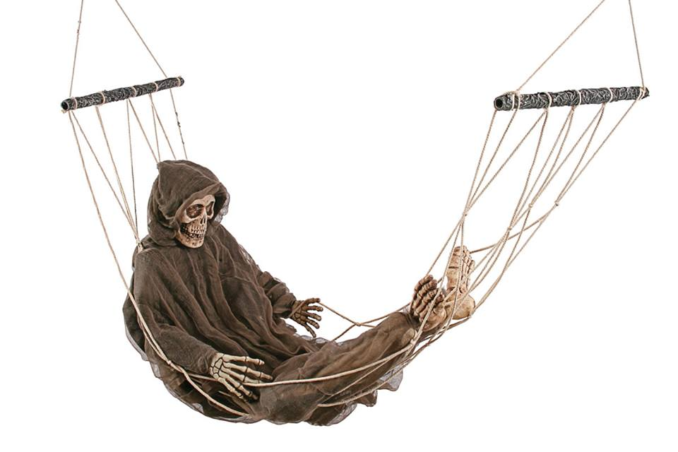 What am I up to? Oh nothing. Just resting my bones. lololol we're so sorry for that one. Photo courtesy of HalloweenMart.