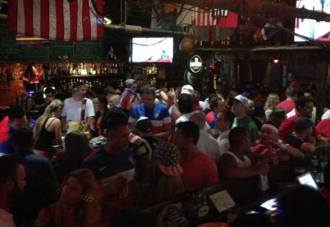 People cheering because a thing happened in soccer. We don't understand that game. Photo courtesy of Crown and Anchor.