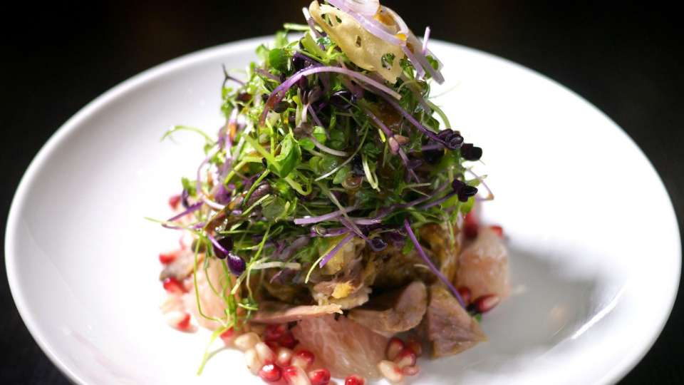 The signature duck salad at Hakkasan, photo courtesy of Hakkasan.
