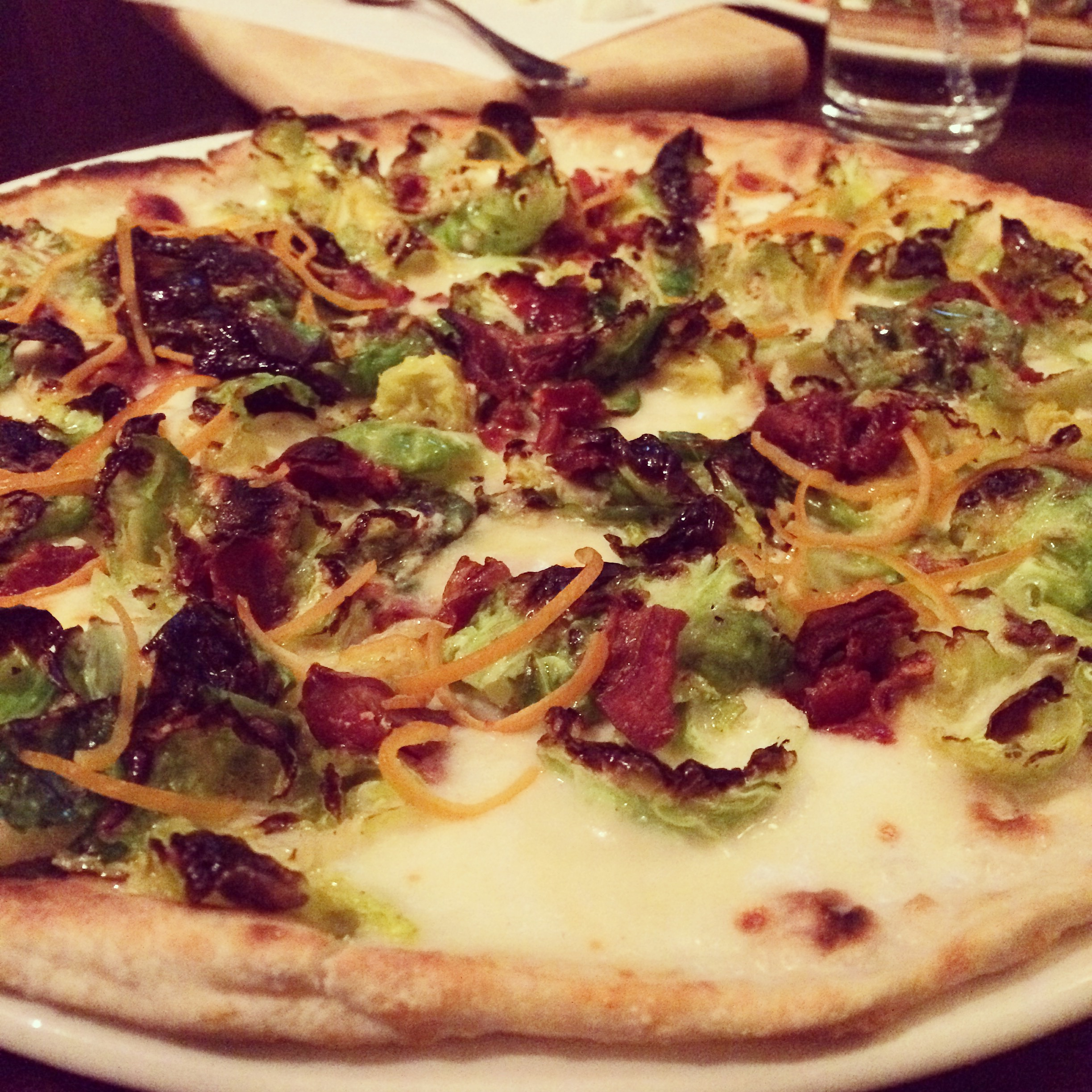 Brussels Sprouts pizza at Otto Enoteca, photo courtesy of Vox Solid Communications.