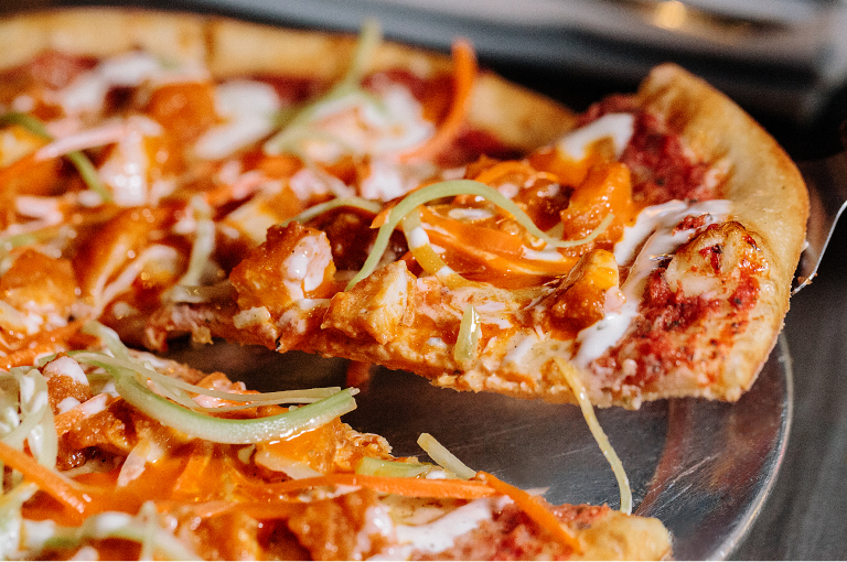 Buffalo chicken pizza, photo courtesy of Slice of Vegas.