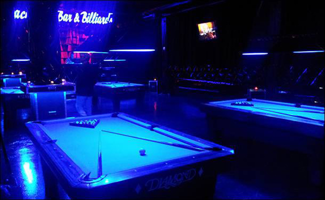 Rack 'em with a black light. Hope that's a mustard stain. Photo courtesy of Backstage Bar and Billiards.