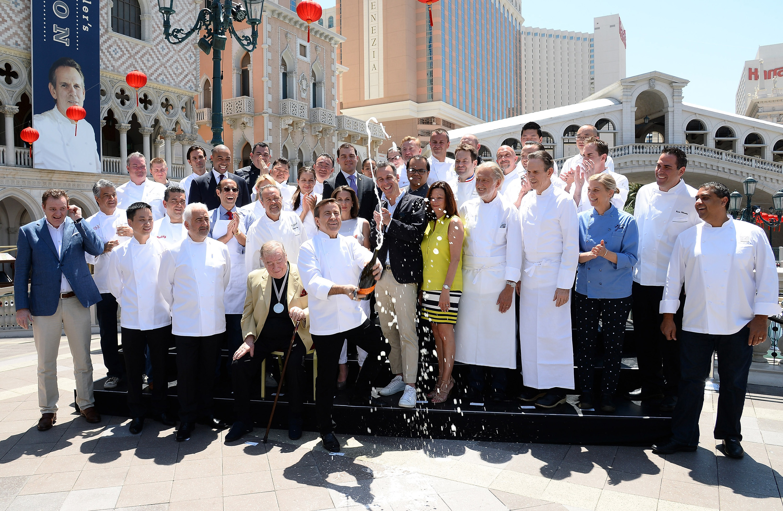 LAS VEGAS, NV - MAY 08: Chef Daniel Boulud (C) marks the beginning of the eighth annual Vegas Uncork'd by Bon Appetit culinary festival, featuring chefs from Aria, the Bellagio, Caesars Palace, the MGM Grand and The Venetian, with a ceremonial Mionetto Prosecco saber-off in front of The Venetian Las Vegas on May 8, 2014 in Las Vegas, Nevada. (Photo by Ethan Miller/Getty Images for Vegas Uncork'd by Bon Appetit) *** Local Caption *** Daniel Boulud