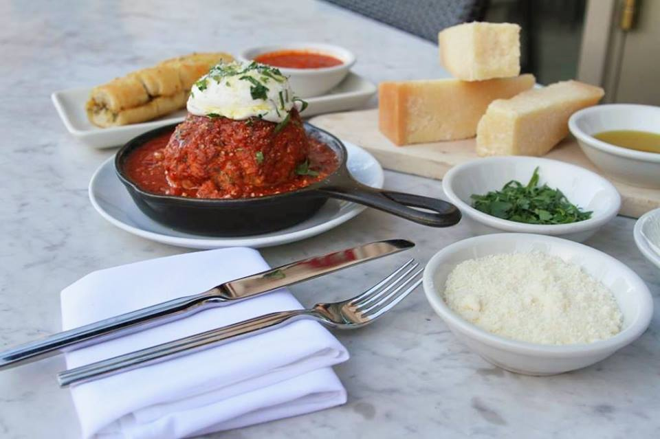 No matter how much you want to, it's considered impolite to slam your whole face into the meatball all at once. Photo courtesy of LAVO.