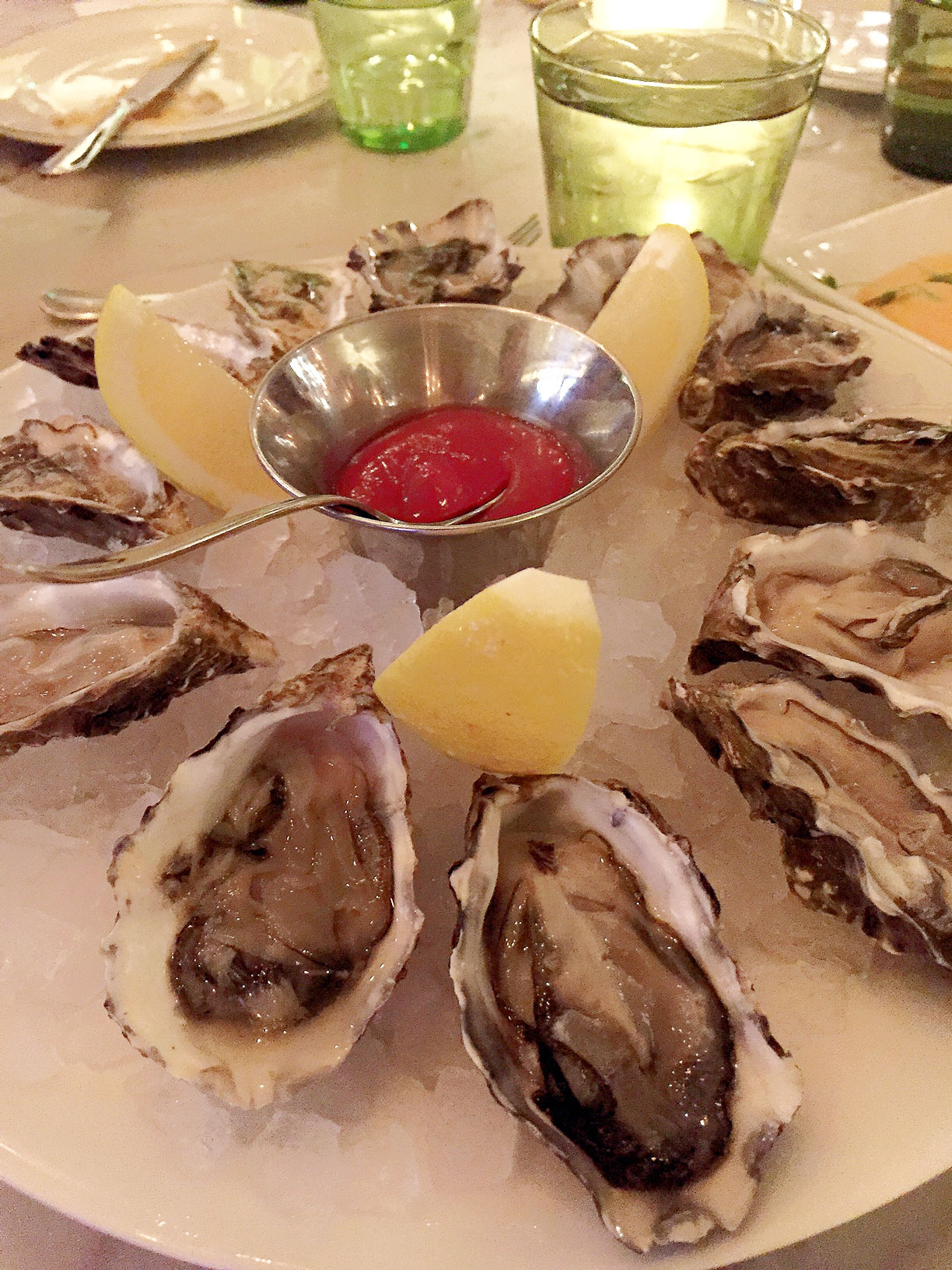 Oysters are $1 during Oyster Hour at db Brasserie. Photo by Kristine McKenzie