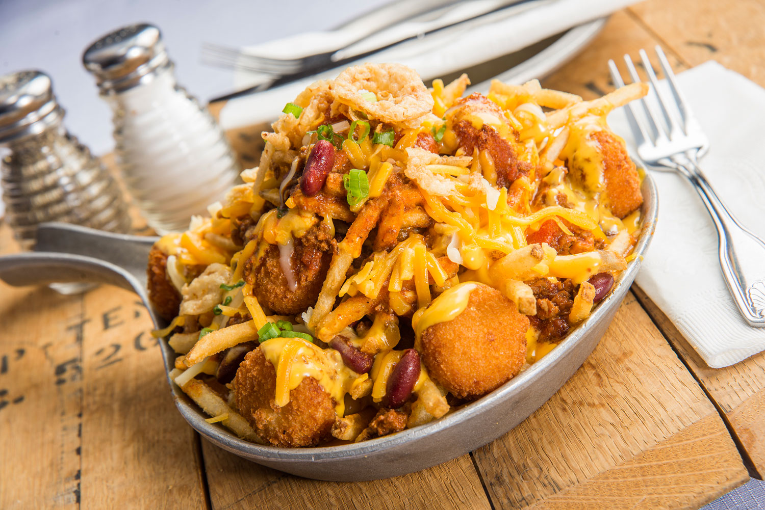 Enjoy sides like cheese fries and tater tots, photo courtesy of Gilley's.